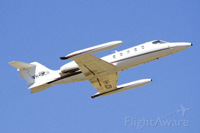 Learjet 35 (VH-JCR) - Getting airborne off runway 23 on the last day of the Australian summer. Thursday 28th February 2013.