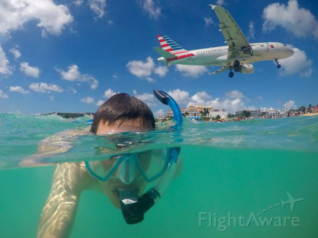 Airbus A319 (N702UW) - Afternoon dive at Maho Beach