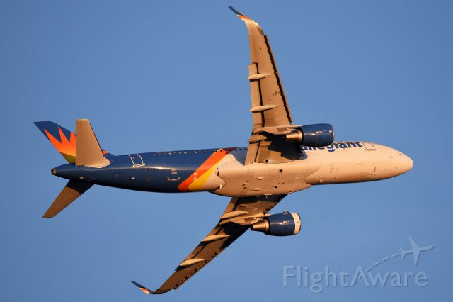 Airbus A320 (N249NV) - Clean belly in the golden rays of the sun late in the day.