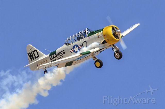 "Grumman AA-5 Tiger (N1038A) - N1038A   1944 North American SNJ-5 C/N 90917 ""War Dog"" - <br /><br />12th Annual Apple Valley Air Show<br /><br />Apple Valley Airport (APV) (KAPV)<br />California, USA<br />TDelCoro<br />October 12, 2013"