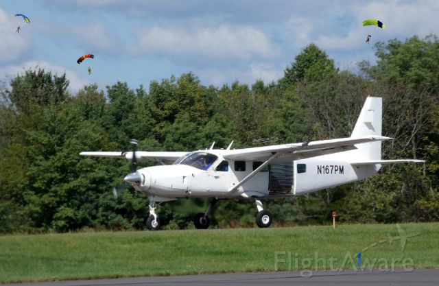 Cessna Caravan (N167PM) - Shown on the departing runway is this Cessna Caravan currently configured for hosting skydiving in the Summer of 2018.
