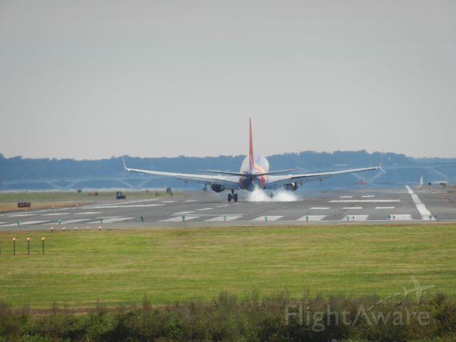 Boeing 737-700 — - A Southwest B737-700 Burnin' Rubber As It Touches Down At Reagan National