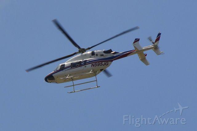 Bell 427 (N595JG) - JOE GIBBS RACING INC flying over R&R BBQ on the way to the track near KJQF - 5/25/19