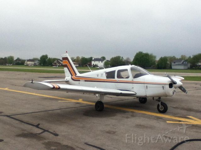 Piper Cherokee (N37DM) - At the pumps.