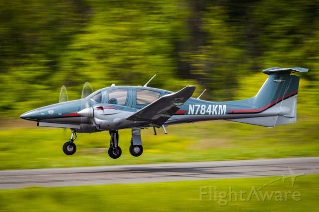 Diamond DA-62 (N784KM) - Panning shot of Diamond DA-62 just getting off the ground at KLOM (Wings Field)br /br /1/100 sec. f/16 500mm ISO 220