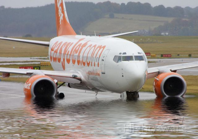 Boeing 737-700 — - A plane from EasyJet trying to get through the high tide of water at the airport. LOL!