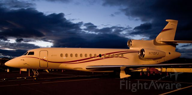Dassault Falcon 7X (N715FJ) - The ramp lighting at KRTS casts a colorful glow over N715FJ, a Dassault Falcon 7X, as the final few minutes of dusk illuminate the sky in the background.  The Falcon was flown in demonstration performance flights during the National Championship Air Race events that concluded yesterday at Reno Stead Airport.