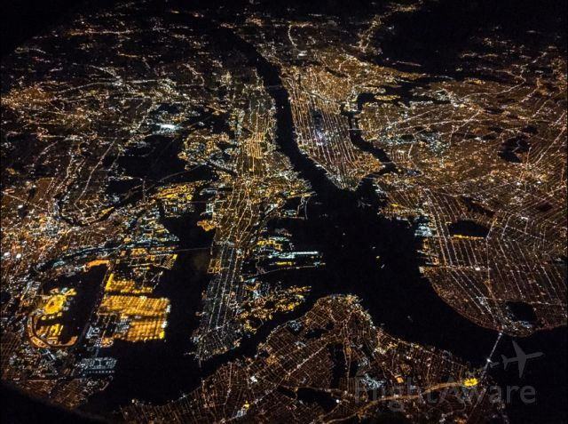 — — - A view of New York City and surrounding areas from my seat on a flight back to Toronto.