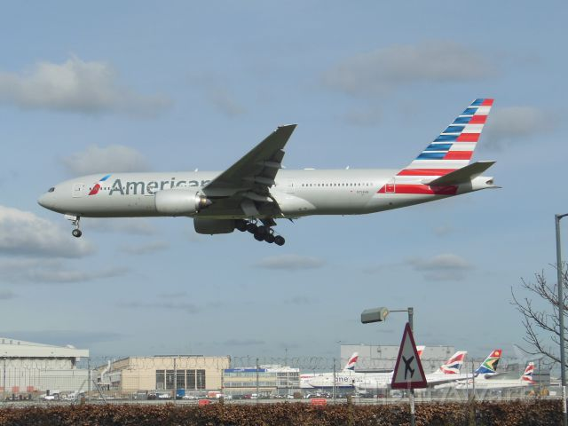 """Boeing 777-200 (N758AN) - American Airlines (AA) N758AN B777-223 ER [cn32637]<br />London Heathrow (LHR). American Airlines flight AA46 arriving from Chicago O'Hare (ORD).<br />Taken from Myrtle Avenue Gardens, Hatton Cross (27L approach)<br />2016 03 03  <a rel=""""nofollow"""" href=""""http://alphayankee.smugmug.com/Airlines-and-Airliners-Portfolio/Airlines/AmericasAirlines/American-Airlines-AA"""">https://alphayankee.smugmug.com/Airlines-and-Airliners-Portfolio/Airlines/AmericasAirlines/American-Airlines-AA</a>"""