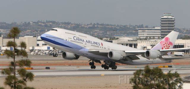 — — - China Airlines rotates off from KLAX 24L
