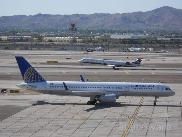 Boeing 757-200 (N18112) - Continental 757-200 at PHX with a Mesa CRJ-900 rotation behind