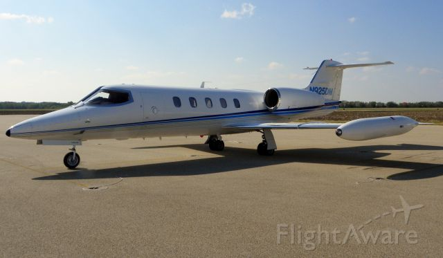 Learjet 35 (N925DM) - Walking along aircraft parking area taking pictures. No problems with TSA or cops.