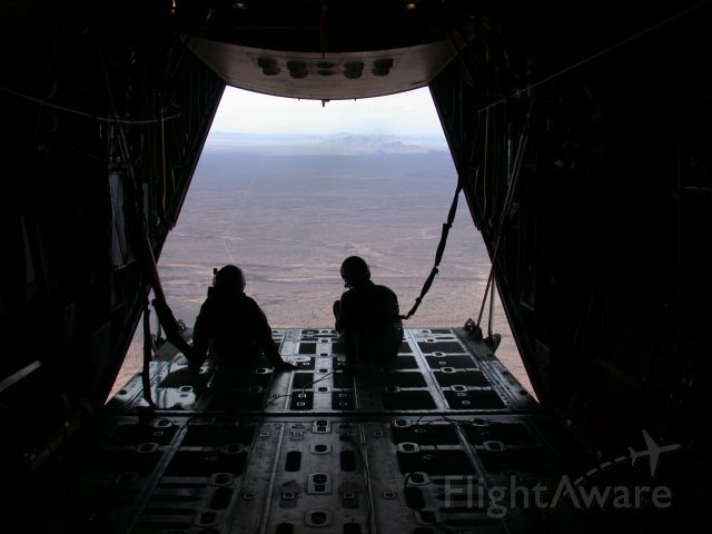 Lockheed C-130 Hercules — - Best view of the Arizona desert EVER!br /Looking out the back of an HC-130P with ramp and door open