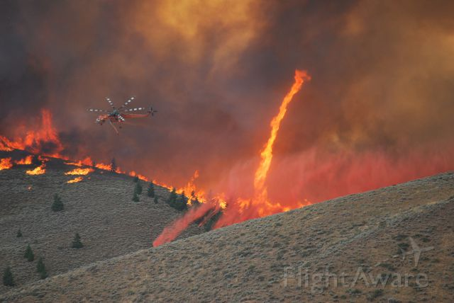 Sikorsky CH-54 Tarhe — - 1967 ERICKSON S64E Rotorcraft dropping during the Beaver creek fire in Blaine County Idaho summer 2013 with a firenado in the background