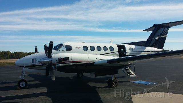Beechcraft Super King Air 200 (N25WC) - Parked in front of Destin Jet FBO.