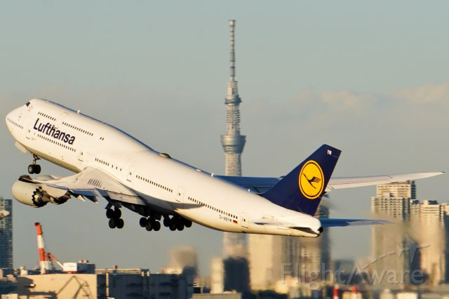 BOEING 747-8 (D-AYBM) - Departure from Haneda with the Tokyo Skytree in the background