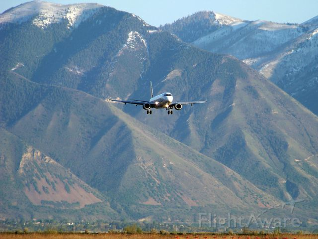 Embraer ERJ-190 (N162HQ) - Quality is a little lower than I hoped for but the backdrop makes for a cool looking shot! Frontier 1655 approaching runway 31 in Provo, UT
