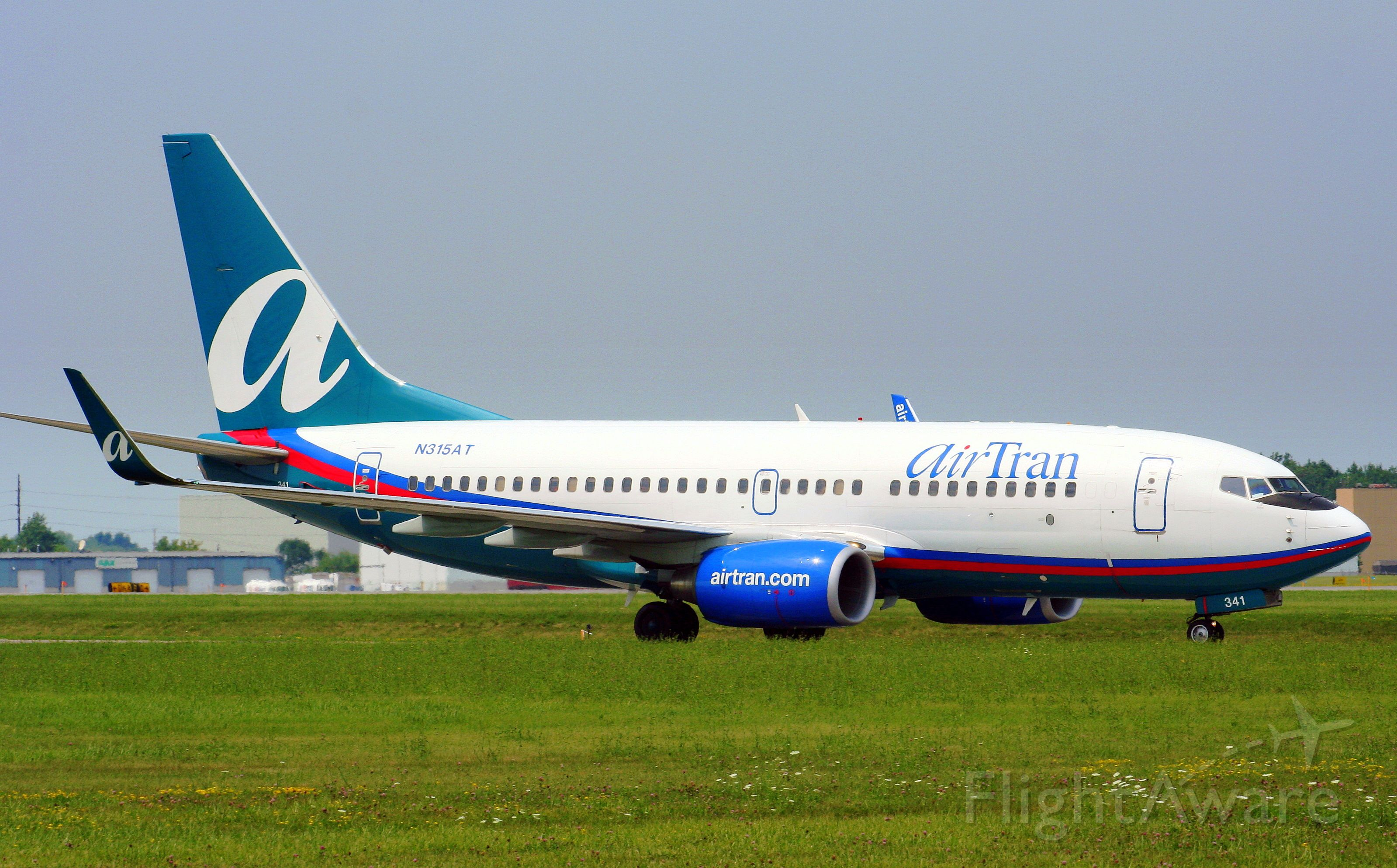 Boeing 737-700 (N315AT) - On arrival, and taxing towards the terminal.
