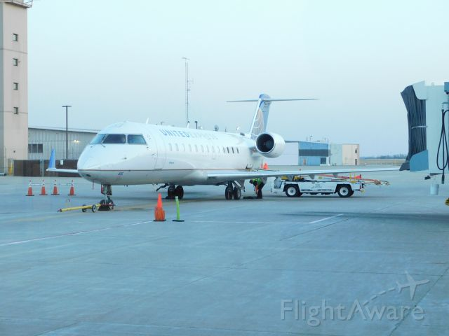 Canadair Regional Jet CRJ-200 (N416AW) - An Air Wisconsin CRJ-200 sitting at the gate at Appleton International Airport after an evening flight from Chicago O'Hare.