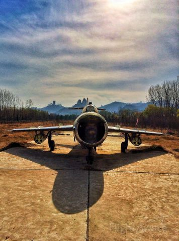 — — - MIG 17 in Central China...on a cement pad, in a field not far from the Yellow River.