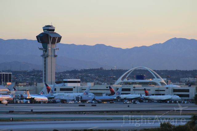 — — - LAX tower and Encounter Restaurant as seen from El Segundo overlook.