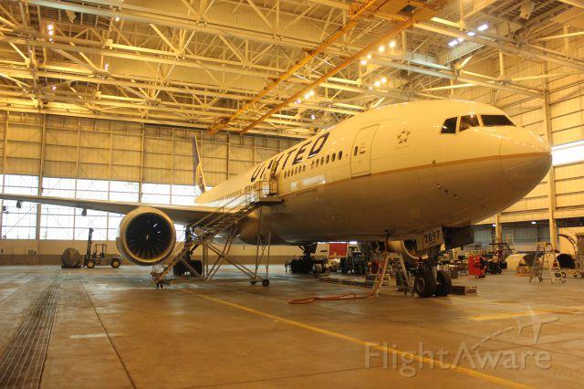 Boeing 777-200 (N797UA) - Left engine change out.