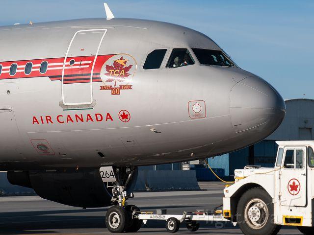 Airbus A319 (C-FZUH) - Push back, US bound morning flight.