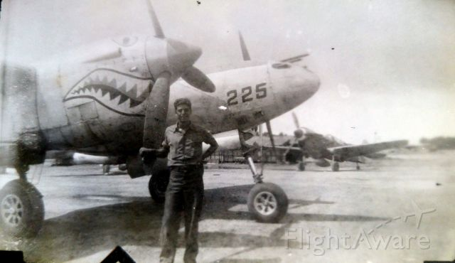 Lockheed P-38 Lightning (225) - My grandpa with nose# 225 (St. Louis Blues) P-38 Lighting, 1945 Philippines. I obviously didnt take this photo, nor do I know who did.