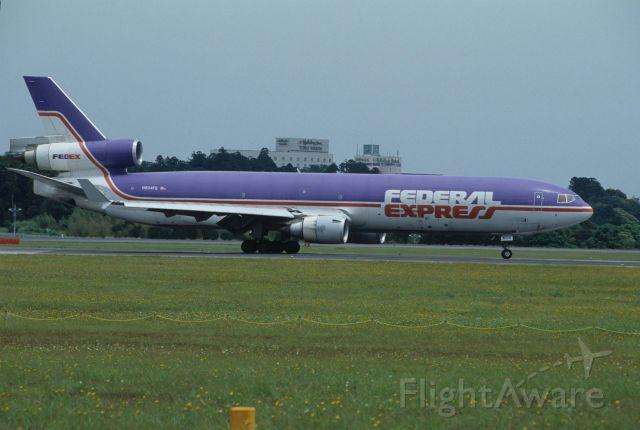 Boeing MD-11 (N604FE) - Departure at Narita Intl Airport Rwy16R on 1995/05/28