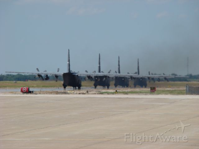 Lockheed C-130 Hercules — - Four C-130s taxiing to leave Salina, Kansas 06212009.  Can you smell the fuel burn in the air?