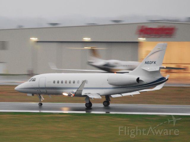 Dassault Falcon 2000 (N60FK) - CHILDRESS KLEIN MANAGEMENT SERVICES LLC touching down in the rain at KJQF - 3/21/10