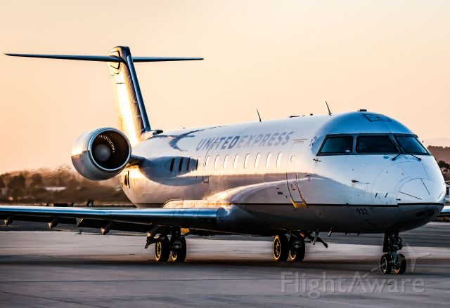 Canadair Regional Jet CRJ-200 (N932EV) - Waiting to taxi at sunset. Fun fact: I flew this bird in 2017 from DEN to MLI
