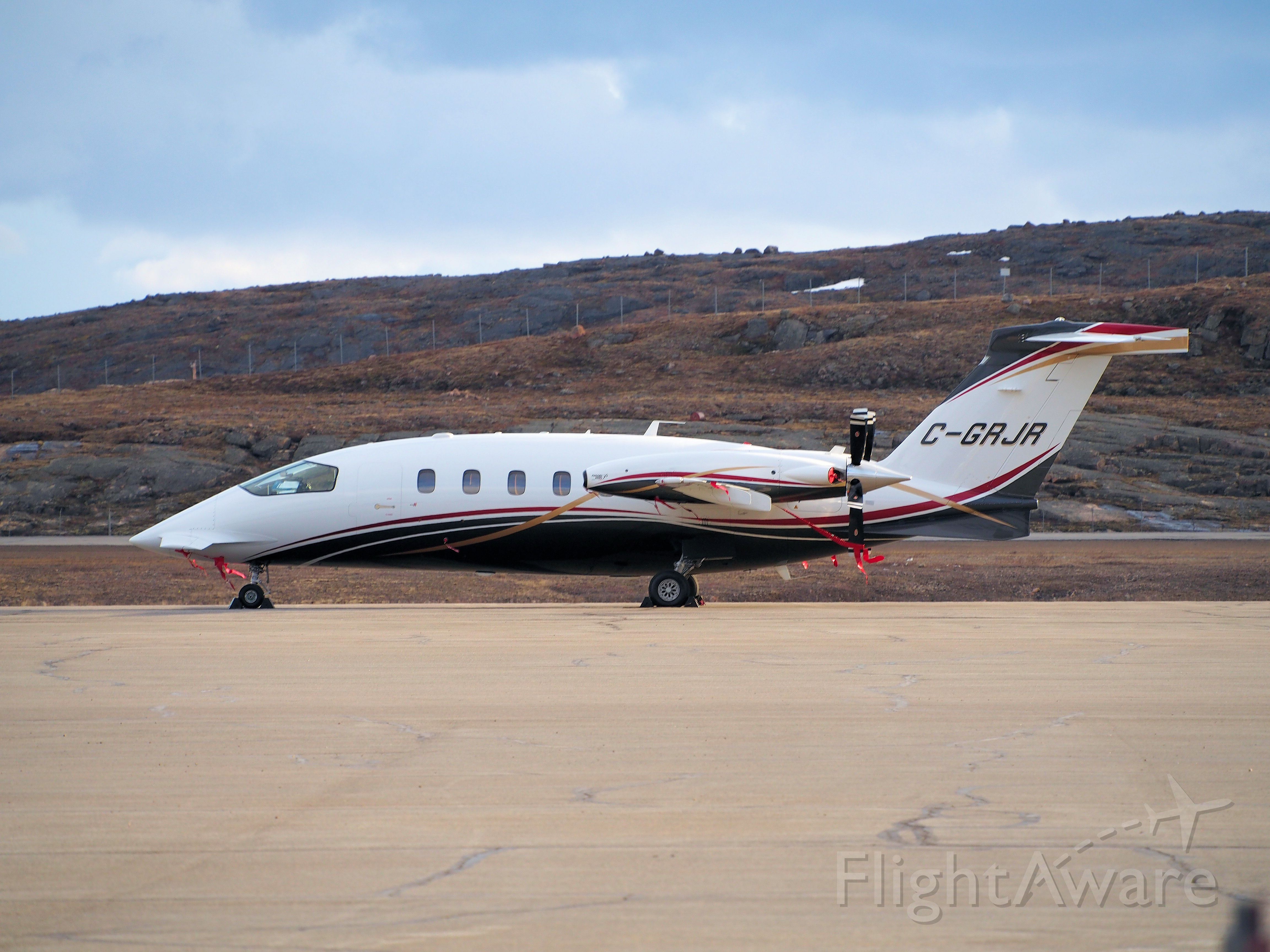 Piaggio P.180 Avanti (C-GRJR) - Parked at the Iqaluit airport. June 9, 2014