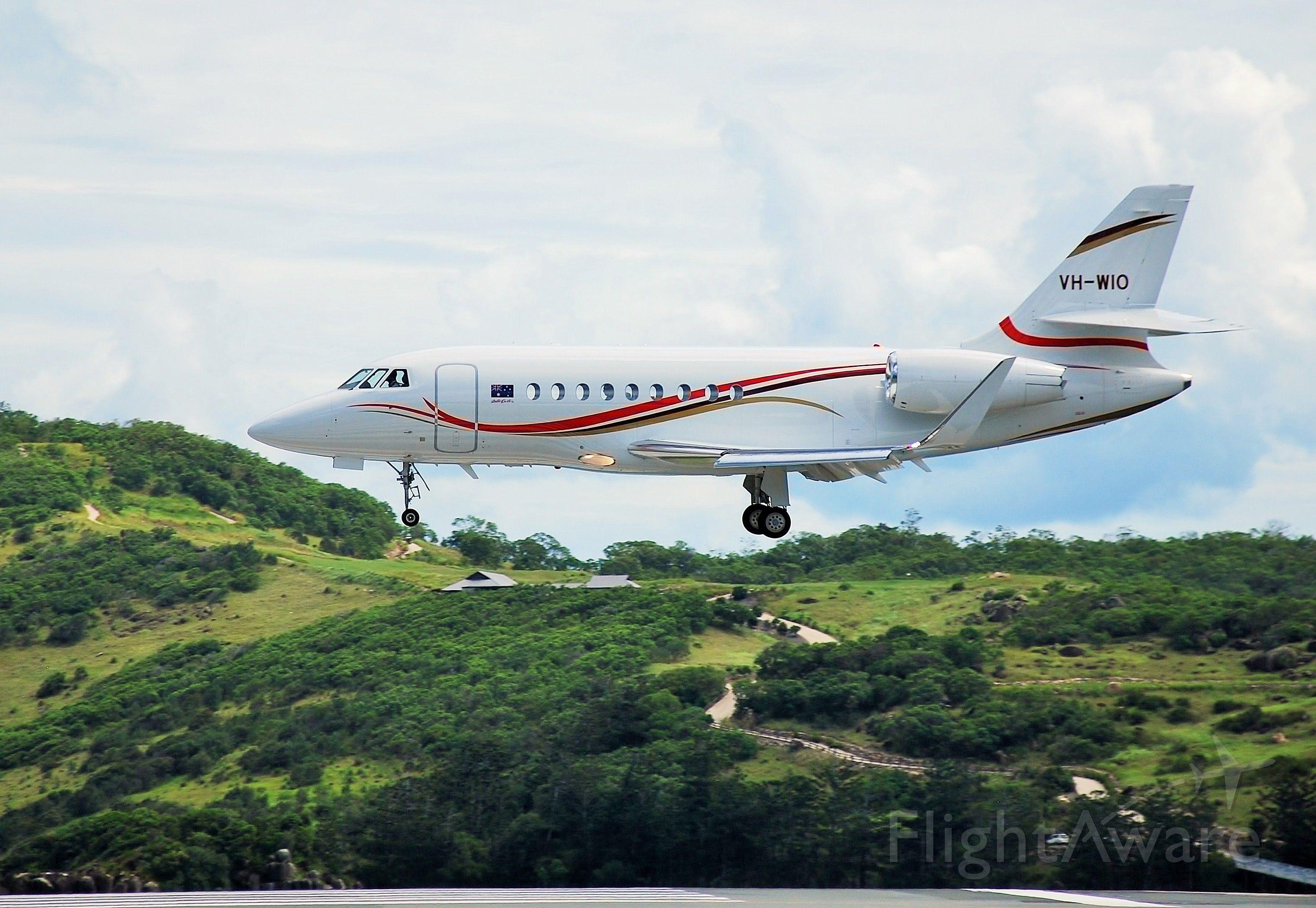 Dassault Falcon 2000 (VH-WIO) - Wild Oats.  Bob Oatleys Falcon landing at his Hamilton Island...
