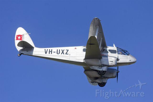 De Havilland Dragon Rapide (VH-UXZ) - de Havilland DH.89A Dragon Rapide (VH-UXZ) flying over Wagga Wagga Airport.