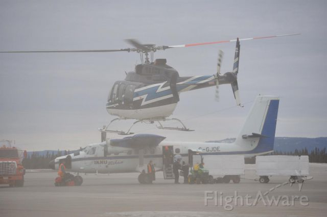 De Havilland Canada Twin Otter (C-GJDE) - Being offloaded at Goose Bay, NL with C-GJKWH kicking up a sand storm.