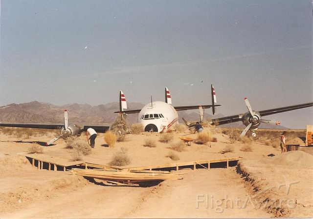 Lockheed EC-121 Constellation (N6937C) - Burrying a Connie 1990. Staging for a movie shot.