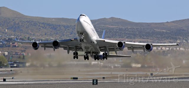 """Boeing 747-400 (N194UA) - Flashback 2013 ~~<br />This """"Flashback"""" photo, taken 7 years ago (Apr 2013) with my old Canon T3i, captured United's N194UA, a B744, as it lifted away from RNO's shorter parallel Runway 16L on an AM departure with a full passenger load of United States Marines and all their equipment. The UA charter was transporting the Marines back to Cherry Point, N. Carolina."""