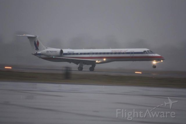 Embraer ERJ-145 (N620AE) - Landing during a snow shower in December 2010 on RNWY 36
