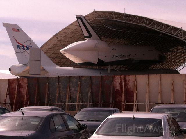 — — - Old 747 with the space shuttle parked at JFK airport