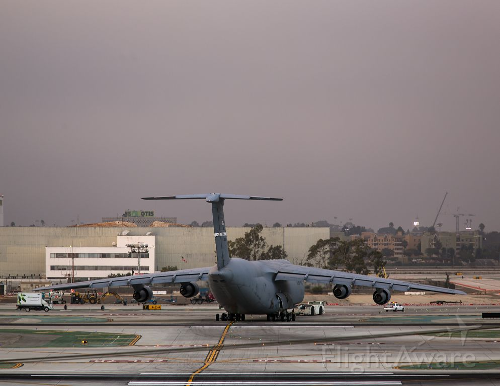 Lockheed C-5 Galaxy (N80216) - Moving a Galaxy from the freight area to remote parking. Photo taken from El Segundo overlook. Sunset, 17 Sept 2013 Los Angeles, California USA