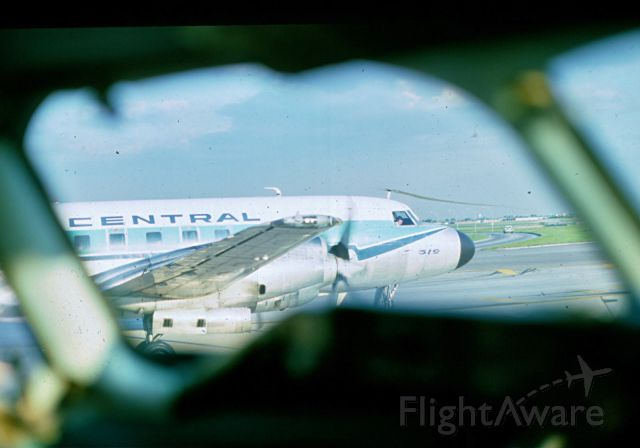 NCA519 — - Convair 580 in KDTW From a parked DC-9