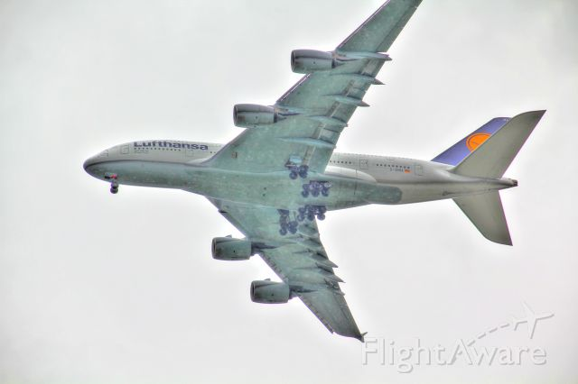 Airbus A380-800 (D-AIMA) - Approach to MCO. Looking from my front yard. Very overcast day.