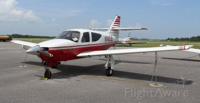 Rockwell Commander 114 (N146BP) - A 1975 model Rockwell Commander 112A (according to the FAA registry) tied down on the Gulf Air Center ramp at Jack Edwards National Airport, Gulf Shores, AL - June 19, 2018.