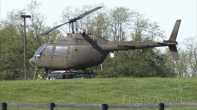 Bell JetRanger (01-6180) - Kentucky National Guard OH-58 Shadow 15 (0-16180) awaits a mission during an escapee search in Versailles, KY April 2010...