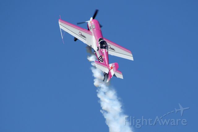 SUKHOI Su-26 (N12SU) - Mike Rinker with Pink Floyd, as the LRAFB Airshow, September 2012
