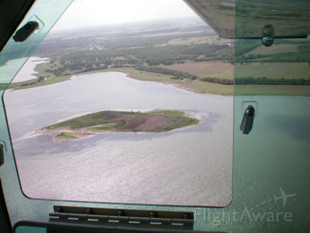 Cessna 177RG Cardinal RG (N2036Q) - View out the openable camera windows.