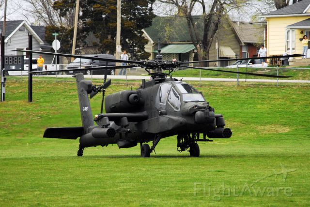 — — - A pair of AH-64s landing on the campus of the University of Central Missouri.