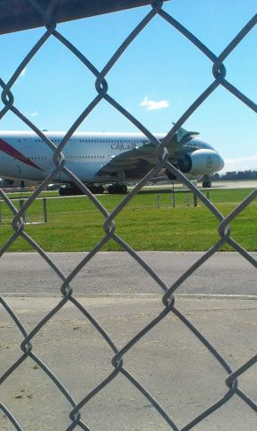 Airbus A380-800 (A6-EUF) - Standing at the gates at yaldhurst back of chch airport when this girl came in!
