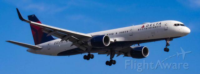 Boeing 757-200 (N690DL) - Delta 757 landing. Taken from Airport loop drive cul-de-sac next to runway 20R.